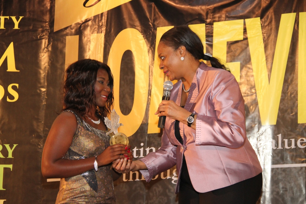 Brenda Ogbuka, Short Script Competition writer receiving her award from Ms. Arunma Oteh