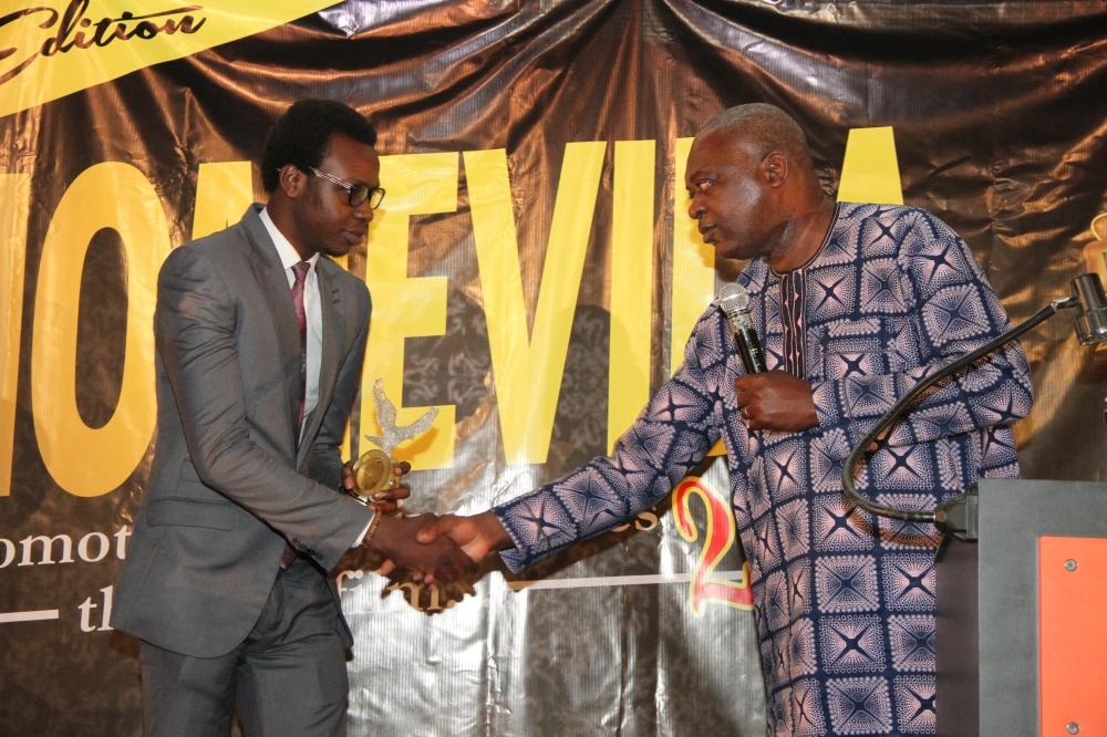 Damilola Orimogunje, Short Script Competition Winner receiving his award from Andy Amenechi